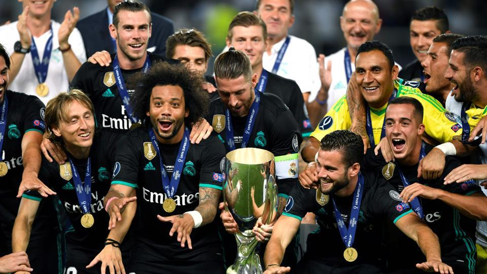 Real Madrid players celebrate with the trophy after winning the UEFA Super Cup against Manchester United on Tuesday at the Philip II Arena in Skopje.