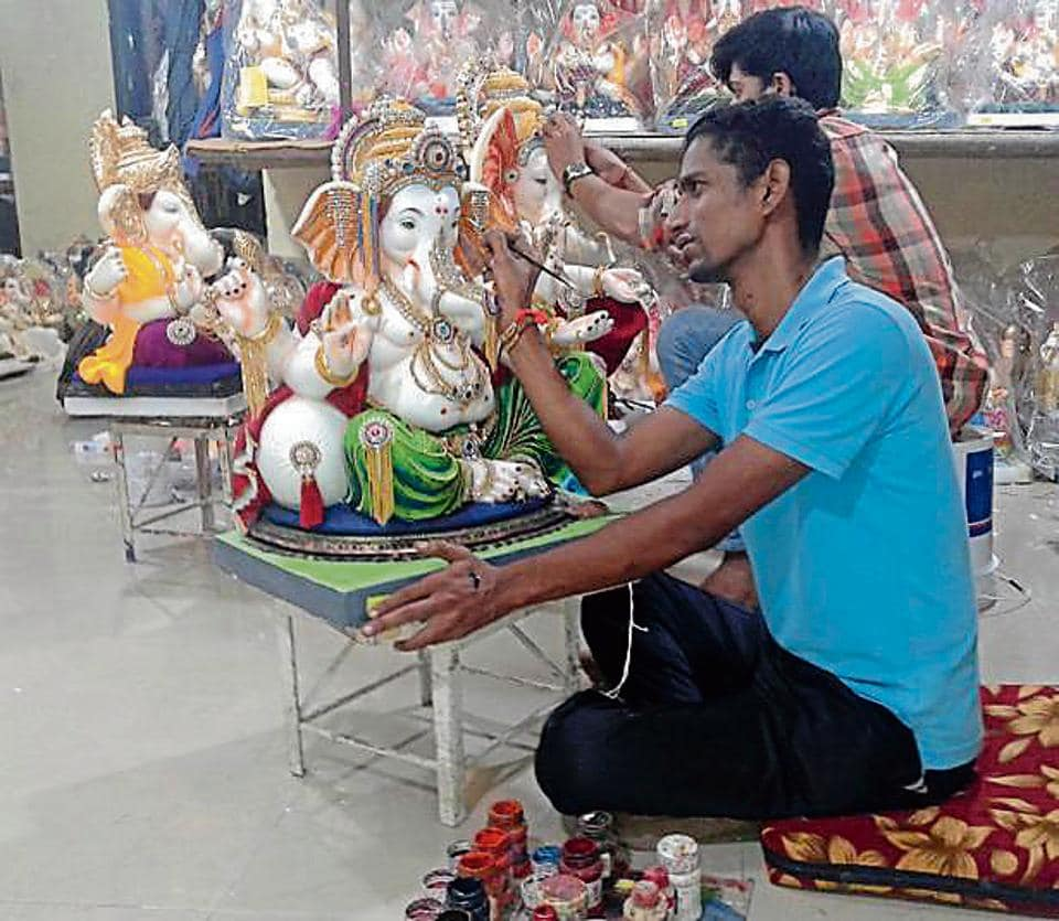 An artisan gives finishing touches to a Ganesha to idol in Kalyan  on Wednesday.