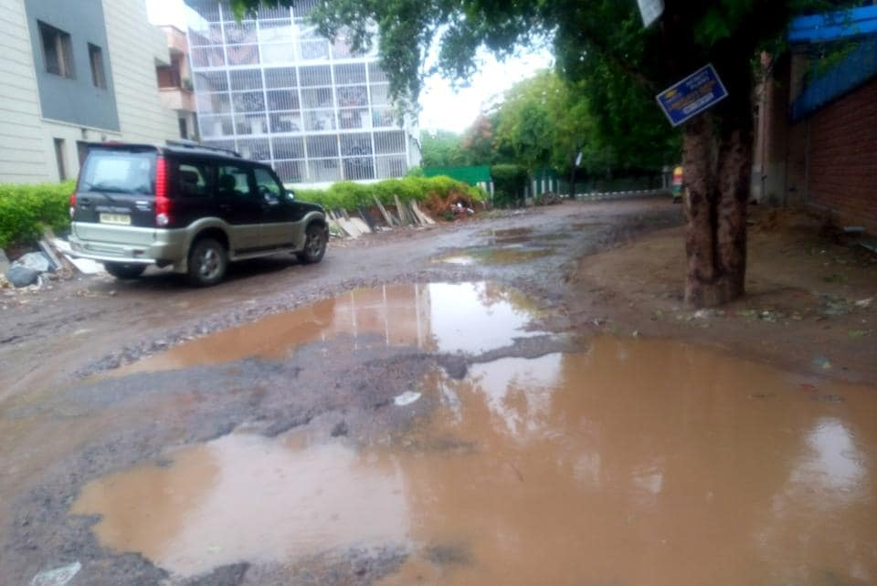 Badly damaged road due to water logging in DLF Phase-1 area.