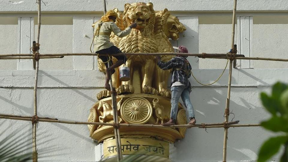 Workers paint a statue of the national emblem, a depiction of the Sarnath Lion Capital of Ashoka, ahead of the 70th year of independence at the state secretariat building in Mumbai, Maharashtra. (Indranil Mukherjee/AFP)