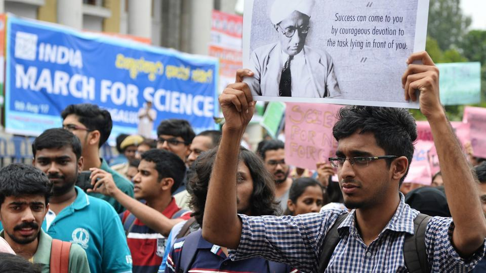 A student holds placards during the March for Science rally in Bengaluru on Wednesday.