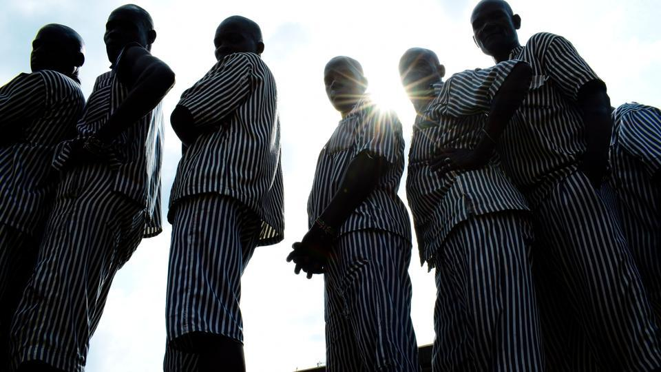 Kenyan inmates wait in line to cast their vote in Kisumu maximum prison in Kisumu, on Lake Victoria. At least 145 inmates have cast their ballot at the Kisumu maximum prison in Kenya. This is the first time that inmates in Kenya are being allowed to vote.  (Kevin Midigo/AFP)