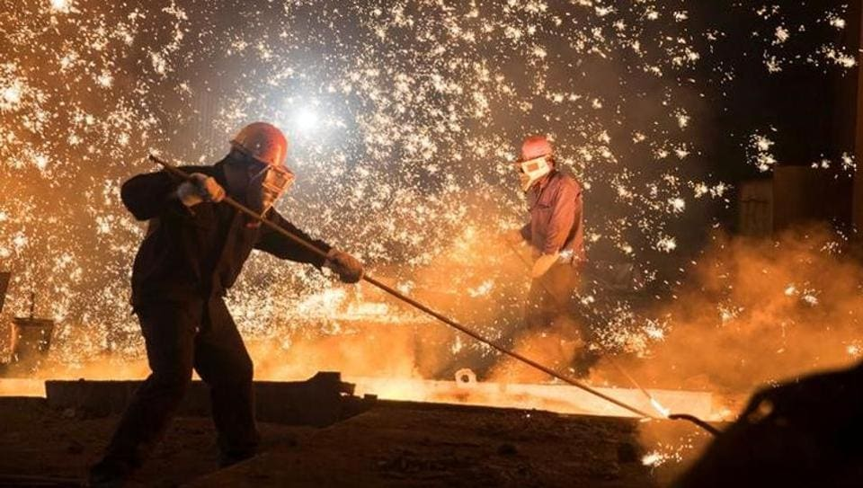 Labourers work at a steel plant in Jinan, Shandong province, China.