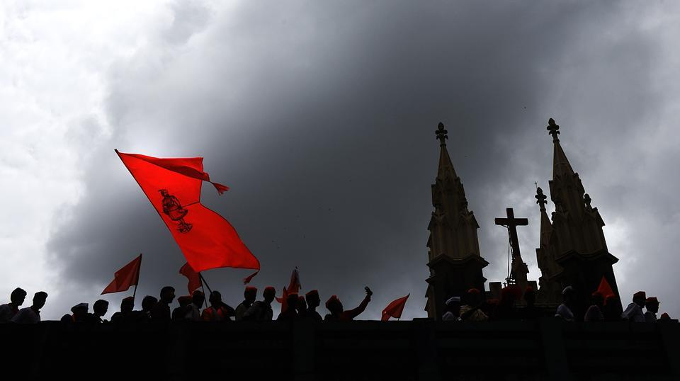 Protesters pass next to Gloria Church. This is likely to be the last rally for the Maratha community. It is their third attempt to hold a march in Mumbai after the first two failed following internal differences. (Pratik Chorge/HT Photo)