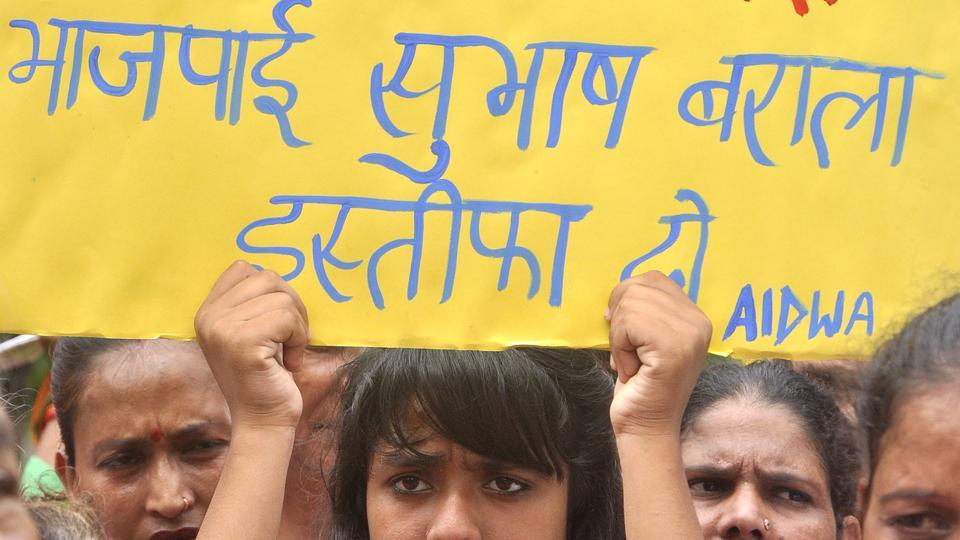 Activists protest against Haryana BJP chief Subash Baral in Panchkula. His son, Vikas Barala, is accused of stalking a woman. The case has mounted pressure on Haryana's BJP-led government.
