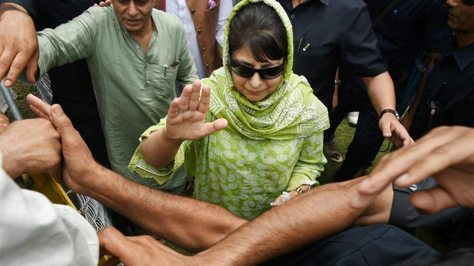 Jammu and Kashmir chief minister Mehbooba Mufti waves at supporters during the Peoples Democratic Party's 18th foundation day celebrations in Srinagar recently.