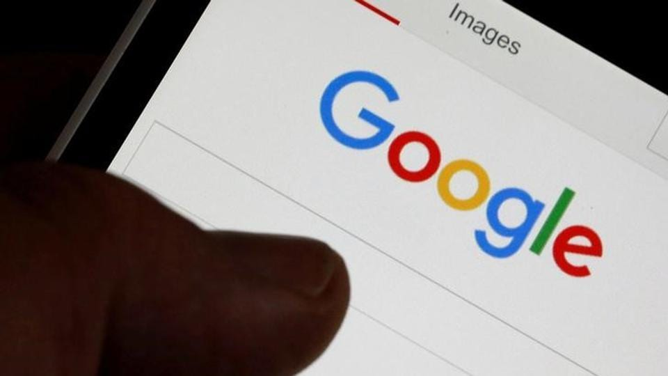 FILE PHOTO: A man holds his smartphone which displays the Google home page, in this picture illustration taken in Bordeaux, Southwestern France, August 22, 2016. REUTERS/Regis Duvignau/File Photo