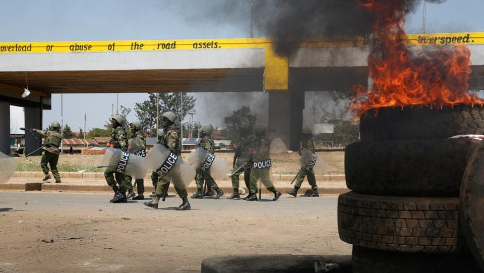 Policemen walk past tyres set on fire by supporters of opposition leader Raila Odinga, after their political leader claimed the early results were 'fake' and 'fictious'. Kenyatta and Odinga have been fierce tribal rivals since the 1960s. Kenyatta is in a bid to avoid becoming the first Kenyan president to lose re-election, meanwhile at Odinga at 72,  is looking at his last chance at the presidency. (REUTERS)