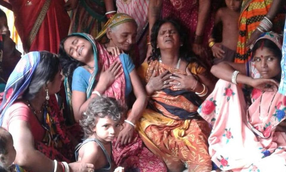 The wailing family members of the victim child.