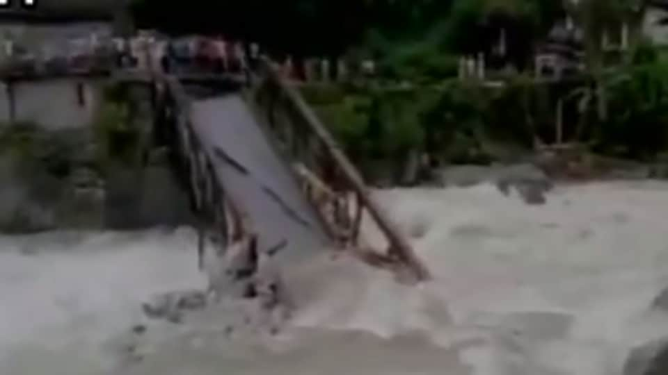 Video grab of a bridge being washed away after cloudburst in Pithoragarh's Madkot on Thursday. The weather department has predicted heavy rains in the next 24 hours