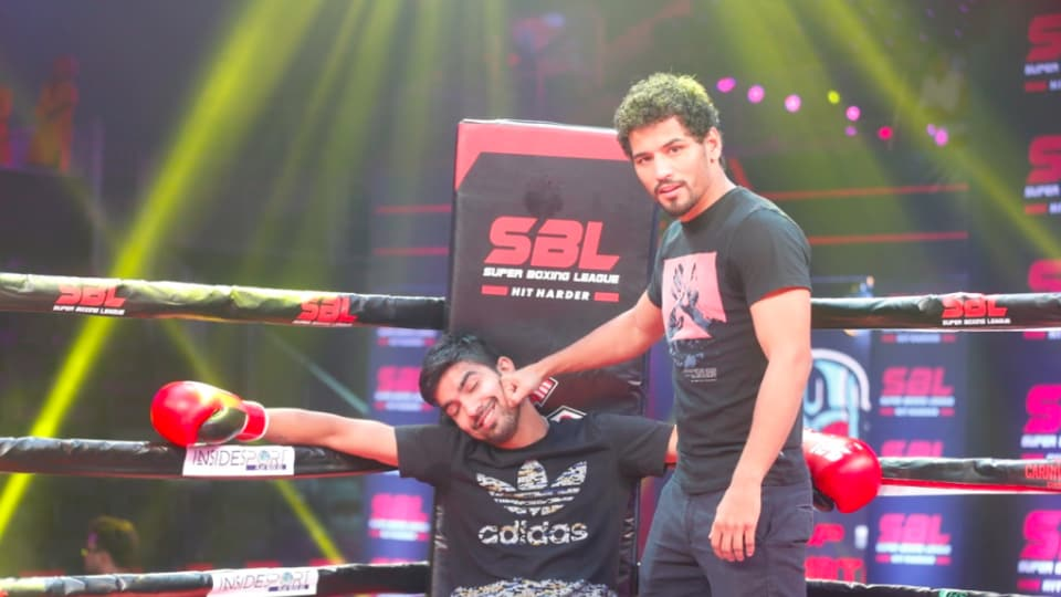 Deepak Singh gets punched in a jovial way by Neeraj Goyat during a practice session ahead of the finale of Super Boxing League.