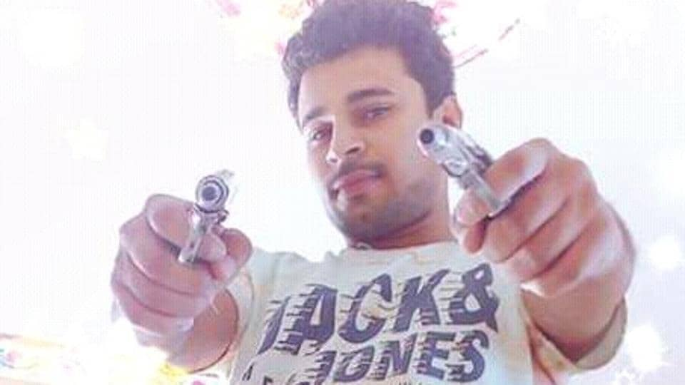 Deepak Kumar Malik has uploaded several photographs on his Facebook  page posing with guns and other arms.