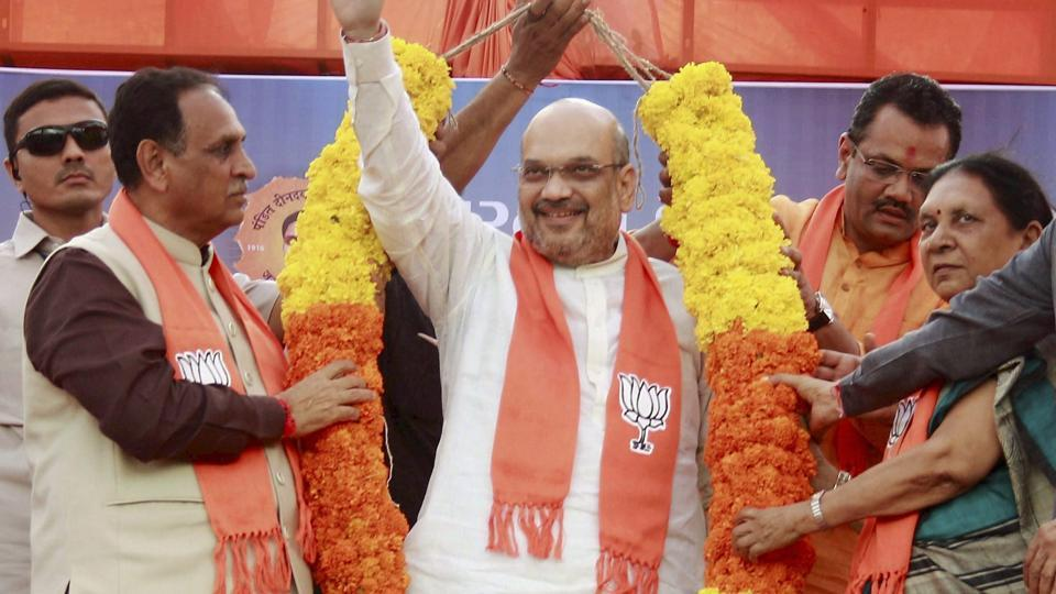 Gujarat Chief Minister Vijay Rupani and former chief minister Anandiben Patel and other BJP leaders felicitate party president Amit Shah for winning Rajya Sabha election, at party office in Gandhinagar on Wednesday.