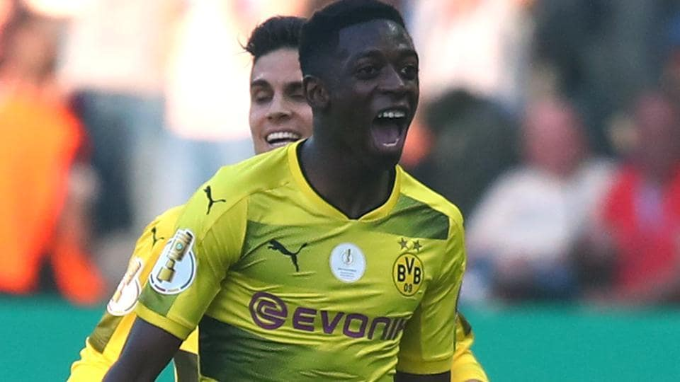 Borussia Dortmund's Ousmane Dembele celebrates after scoring their first goal against Bayern Munich.