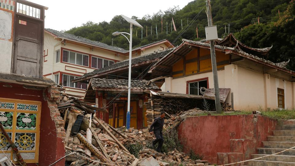 A man walks through the debris of a building that was damaged during an earthquake next to a temple compound in Jiuzhaigou, Sichuan province, China, August 10, 2017.