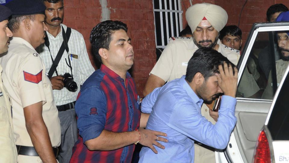 Accused Vikas Barala (in blue shirt) being taken into Chandigarh police custody on Wednesday.