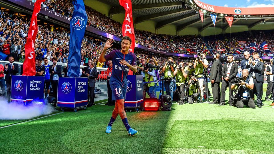 Paris Saint-Germain's Brazilian forward Neymar gestures as his arrives during his presentation to the fans at the Parc des Princes stadium in Paris on August 5, 2017. Neymar signed from Barcelona for a mind-boggling 222 million euros ($264 million).