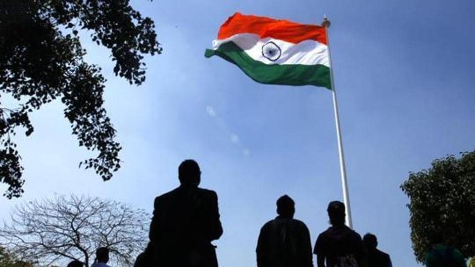 People stand for National Anthem during flag hoisting at Central Park in Rajiv Chowk , in New Delhi.