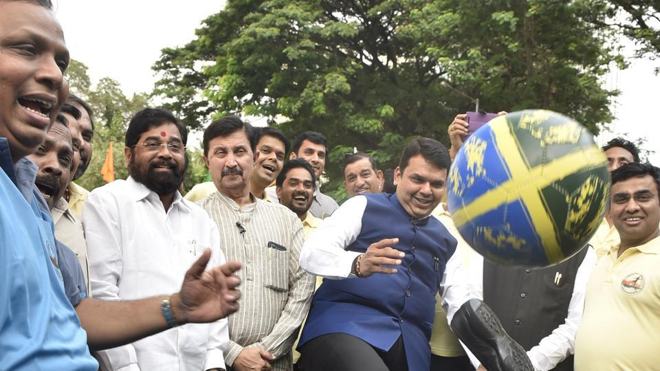 SHOE-MARKER: CM Devendra Fadnavis' shoe goes flying with the ball as he kicks off a football match between the Speaker's Eleven and Chairman's Eleven. The state's legislators played a game at Vidhan Bhavan on Thursday to promote the upcoming FIFA U17 World Cup. (Anshuman Poyrekar/HT Photo)
