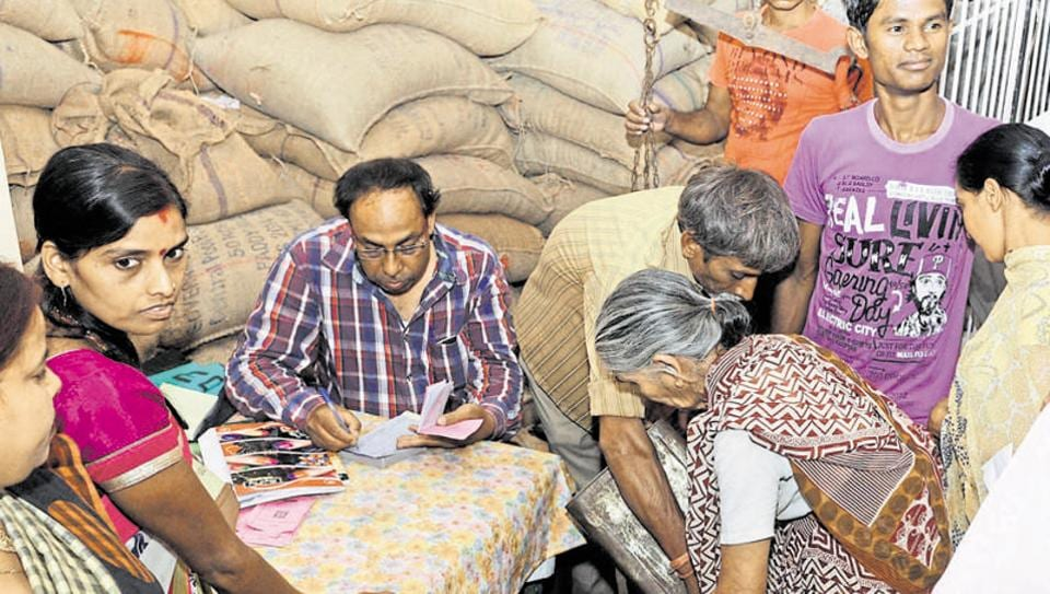 Public purchasing food grain distributed through PDS shop by the new ration card issued by the state government in Ranchi , India, on Sunday, October 11, 2015.