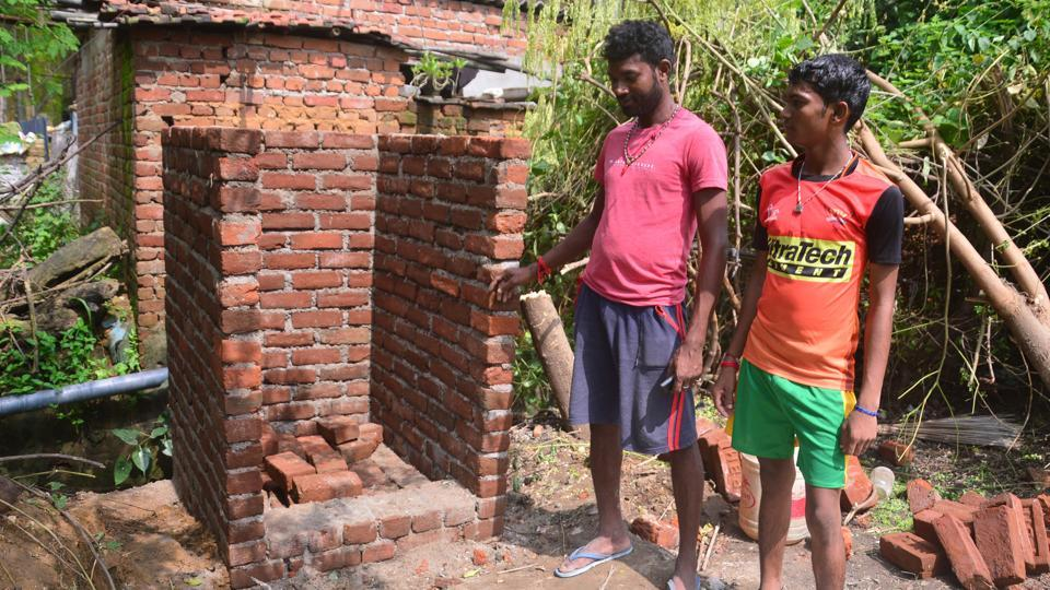 Rajesh Mahto shows his uncompleted toilet under the Swachh Bharat Abhiyan.
