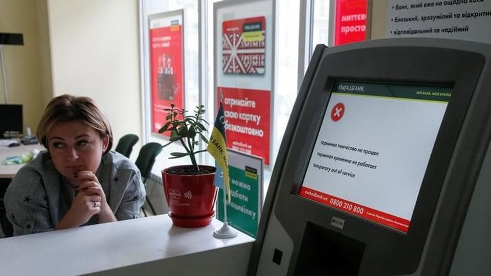 An employee sits next to a payment terminal out of order at a branch of Ukraine's state-owned bank Oschadbank after Ukrainian institutions were hit by a wave of cyber attacks earlier in the day, in Kiev, Ukraine, June 27, 2017.