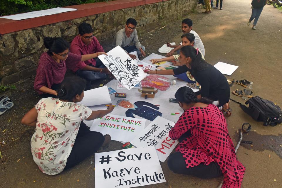 Students of Karve Samajseva Saanstha make posters for the protest in Pune.