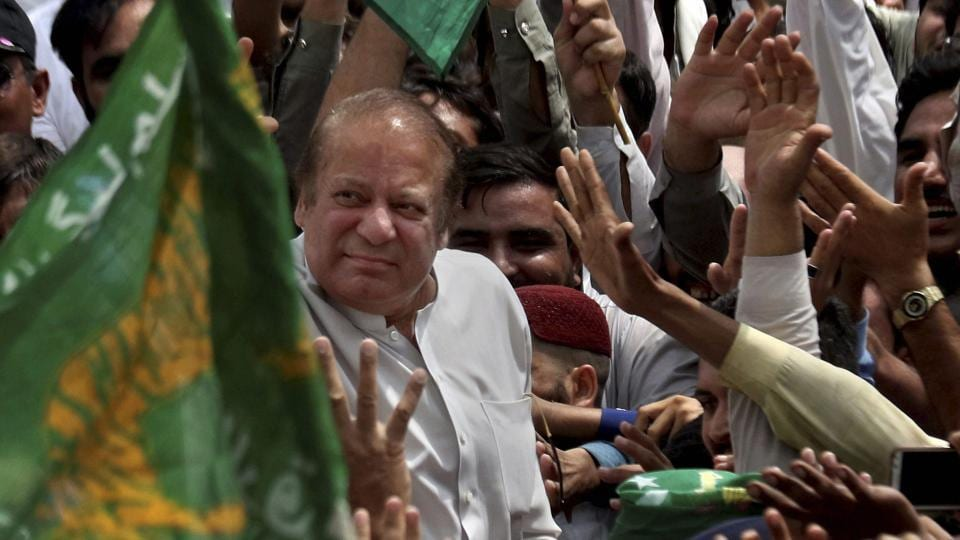 Pakistan's former Prime Minister Nawaz Sharif waves to supporters, who gathered on a highway to welcome him at Bhara Kahu area on the outskirts of Islamabad, Pakistan, August 5