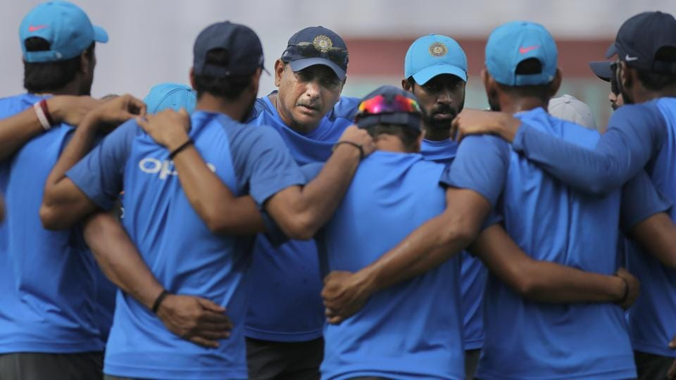Indian cricket team coach Ravi Shastri, center facing camera, speaks to players before the beginning of the fourth day of the first Test cricket match between India and Sri Lanka in Galle, Sri Lanka, on July 29, 2017. India will play a long home season after the series in Sri Lanka.