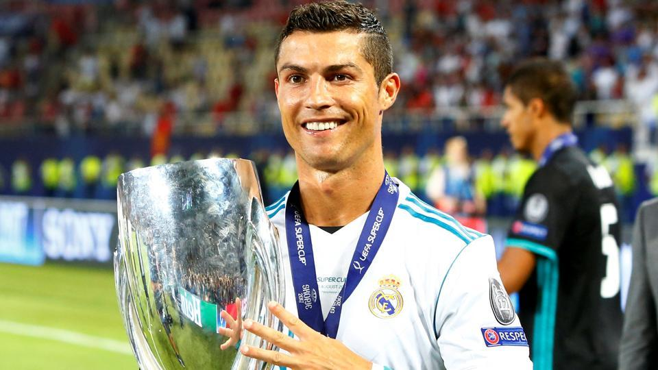 Real Madrid's Cristiano Ronaldo with the trophy as he celebrates winning the Super Cup Final.