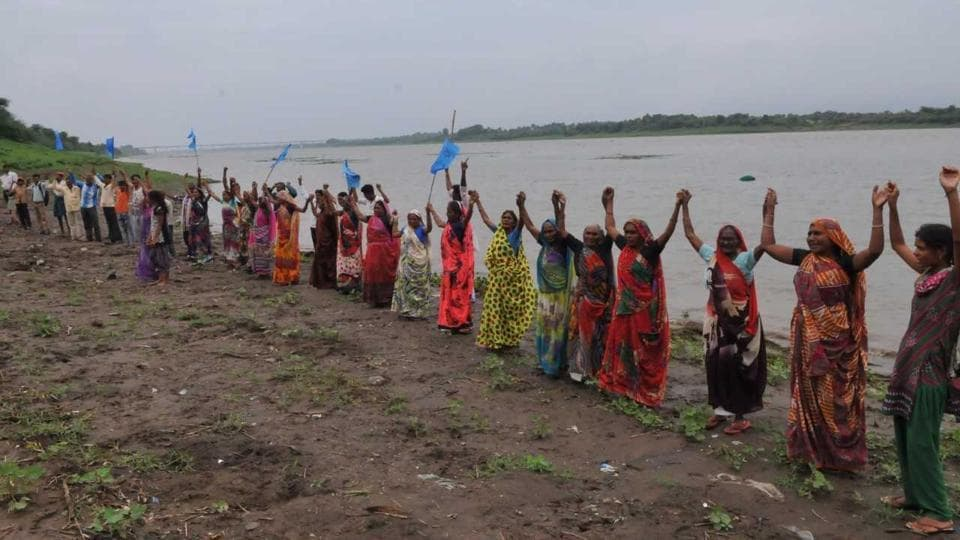 Villagers stage a demonstration seeking permanent rehabilitation before being evacuated  from the banks of Narmada, in Madhya Pradesh's Barwani district.