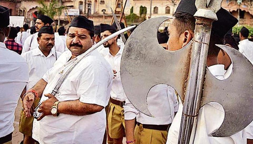 RSS workers take part in a shastra puja. A similar event will be held on Bijoya Dasami in West Bengal. (HT file photo)