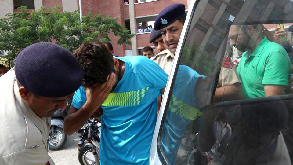 Ashish Kumar being produced in district courts in Chandigarh on Thursday.