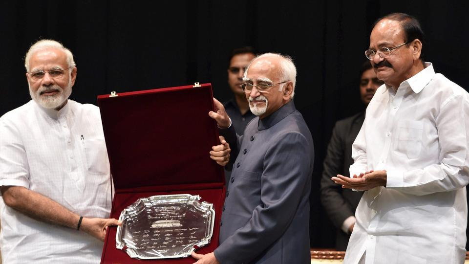 Outgoing vice president Hamid Ansari being presented a memento by Prime Minister Narendra Modi as vice president-designate M Venkaiah Naidu looks on, during his farewell function at GMC Balayogi Auditorium at Parliament in New Delhi on Thursday.
