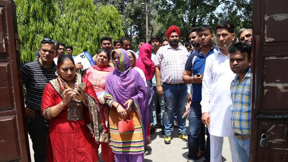 Parents and relatives of students waiting outside an exam centre in Chandigarh, May 2017. Parents serve as adolescents' role models and their behaviour shapes adolescents' views and understanding of the world around them.