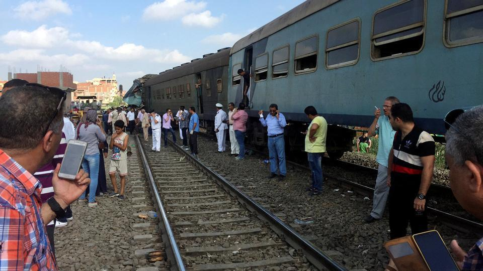 Egyptians look at the crash of two trains that collided near the Khorshid station in Egypt's coastal city of Alexandria, Egypt on Friday.