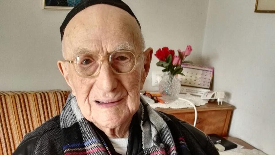 File photo taken on January 22, 2016 shows Yisrael Kristal sitting in his home in the Israeli city of Haifa.