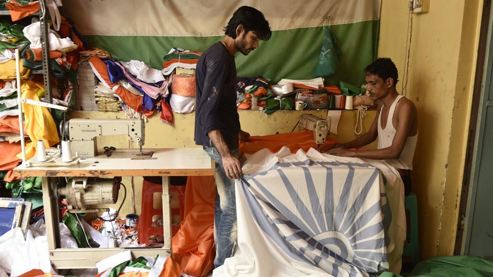 Several families in Old Delhi's wholesale market area of Sadar Bazar have been engaged in making the national flag for decades. The months leading up to period around August 15 are  especially busy as orders start pouring in from all parts of the country. (Burhaan Kinu / HT Photo)