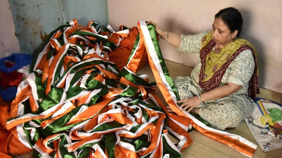 According to the flag makers in these workshops orders this year are more elaborate in their specifications compared to previous occasions. There has been a rise in demand for larger flags, ranging in the 20-30 ft range this year, many of which are headed to the border areas. (Burhaan Kinu / HT Photo)
