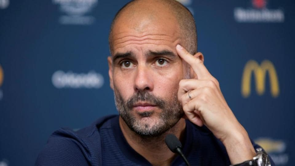 Manchester City's Manager Pep Guardiola waits to answer a reporter's question during a news conference.