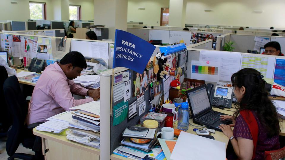 Employees of Tata Consultancy Services (TCS) at the company headquarters in Mumbai.