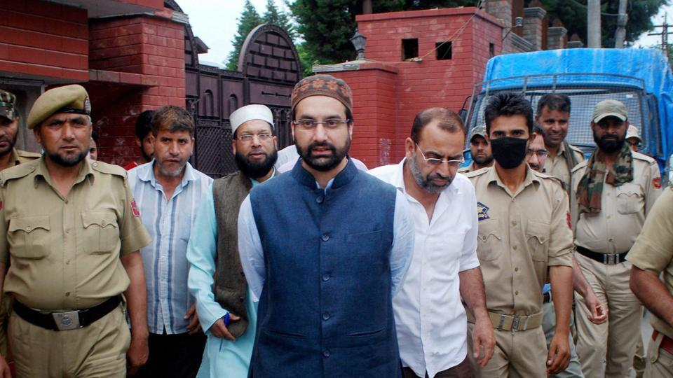 Mirwaiz Umar Farooq being detained by the police in Srinagar on July 13.