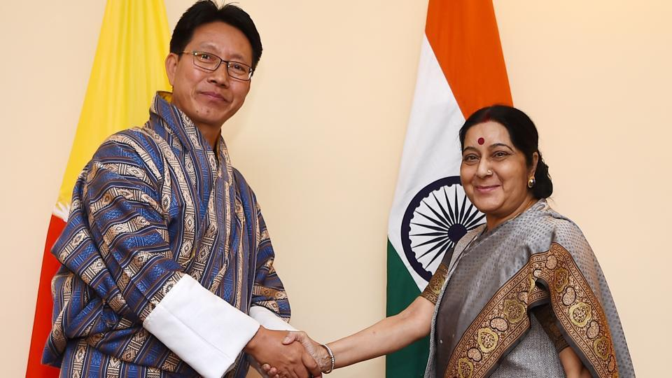Foreign minister Sushma Swaraj (R) shakes hands with Bhutanese counterpart Damcho Dorji ahead of a bilateral meeting in Kathmandu on August 11, 2017.
