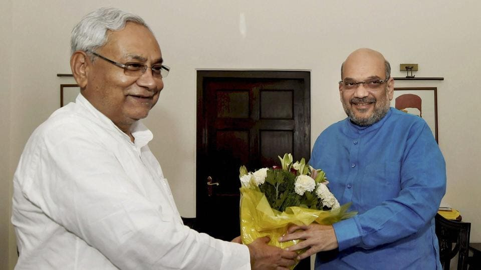 Bihar CM Nitish Kumar greets BJP president Amit Shah during a meeting in New Delhi.