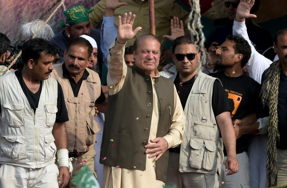 Nawaz Sharif waves to supporters during a rally in Gujrat city in Punjab province on August 11, 2017.