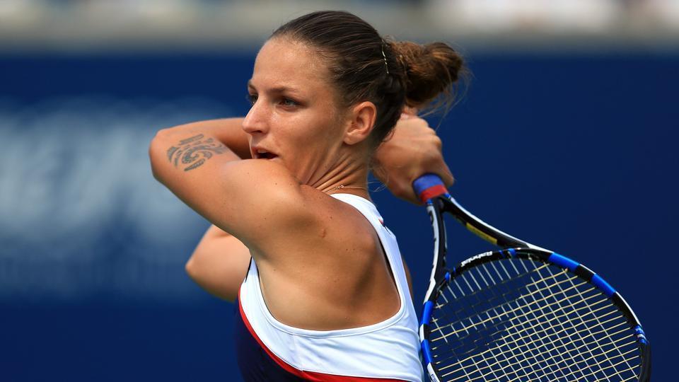 Karolina Pliskova plays a shot against Naomi Osaka. Pliskova would win the match after Osaka retired with an injury.
