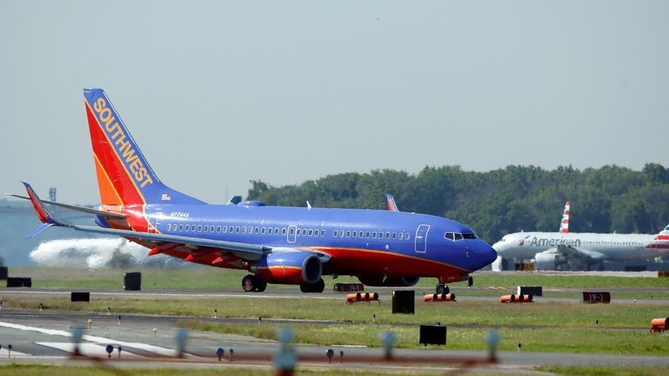 A Southwest Airlines jet taxis on the runway at Washington National Airport in Washington.
