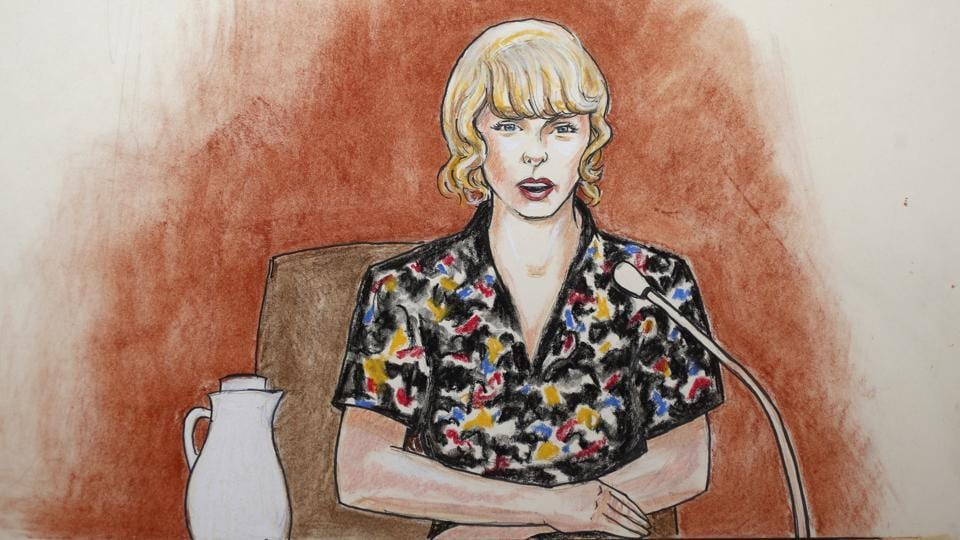 In this courtroom sketch, pop singer Taylor Swift speaks from the witness stand during a trial on Thursday.