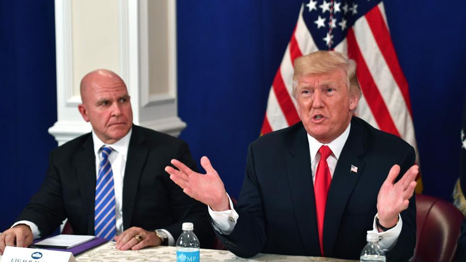US President Donald Trump, with National Security Advisor H. R. McMaster, speaks during a security briefing on August 10, 2017, at his Bedminster National Golf Club in New Jersey. / AFP PHOTO / Nicholas Kamm