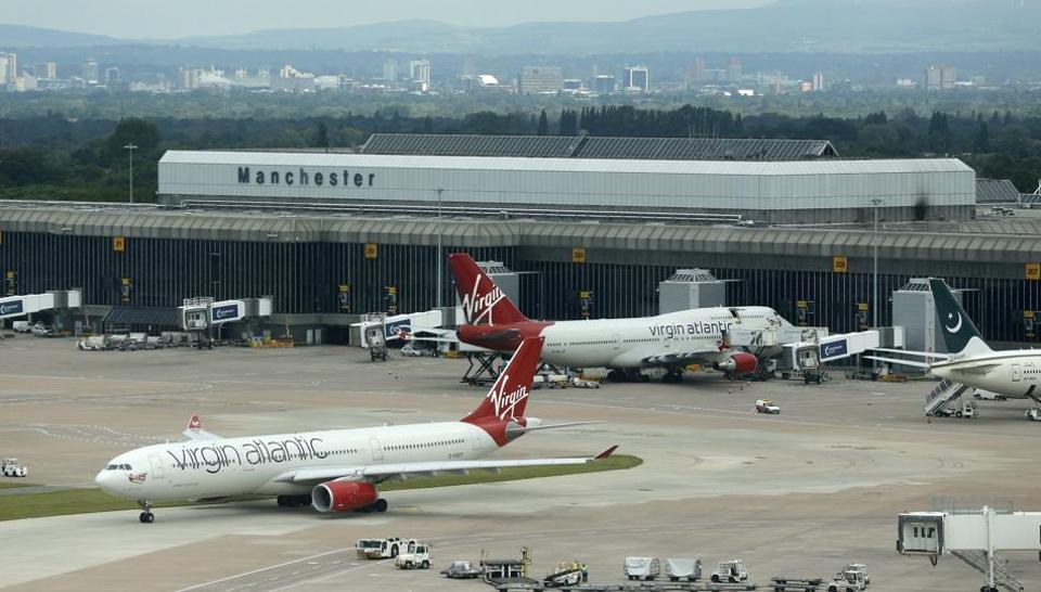 Virgin Atlantic aircraft taxi across the tarmac at Manchester Airport at Manchester Airport, northern England June 25, 2013.